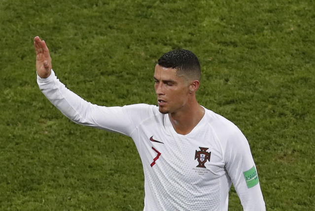 Portugal's Cristiano Ronaldo leaves the pitch after his team was eliminated during the round of 16 match between Uruguay and Portugal at the 2018 soccer World Cup at the Fisht Stadium in Sochi, Russia, Saturday, June 30, 2018. (AP Photo/Darko Vojinovic)
