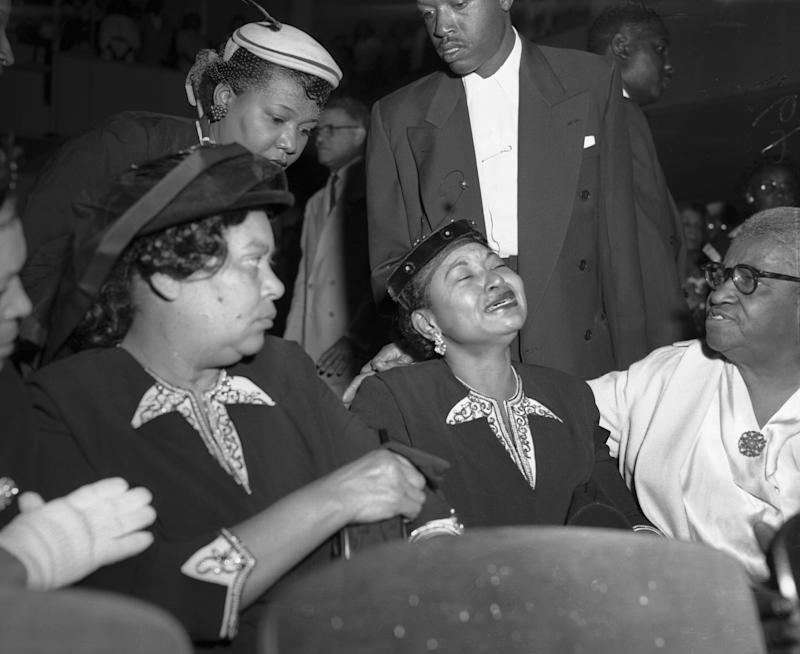 Mamie Bradley (center), Emmett Till's mother, at his funeral. She insisted on having an open casket funeral for him so the world could see what was done to him. (Bettmann / Getty Images)