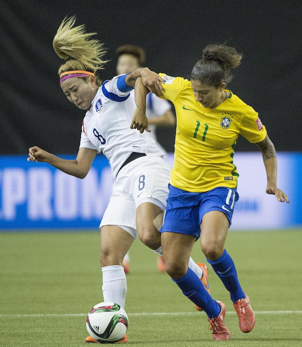 Brazil's Cristiane (11) challenges South Korea's Cho Sohyun (8) during the first half of a FIFA Women's World Cup soccer match Tuesday, June 9, 2015, in Montreal, Canada. (Graham Hughes/The Canadian Press via AP)