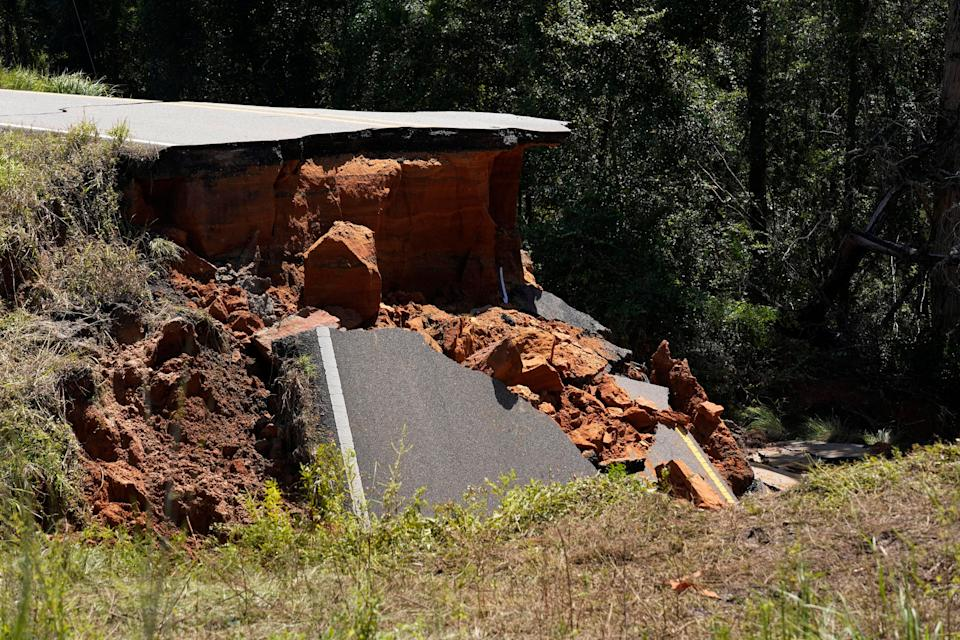 Two people were killed and at least 10 others were injured when seven vehicles plunged into a deep hole on Mississippi Highway 26, which collapsed Aug. 30 after Hurricane Ida blew through the state.