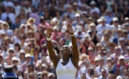Serena Williams of the U.S.A celebrates after winning her Women's Final match against Garbine Muguruza of Spain at the Wimbledon Tennis Championships in London, July 11, 2015. REUTERS/Toby Melville