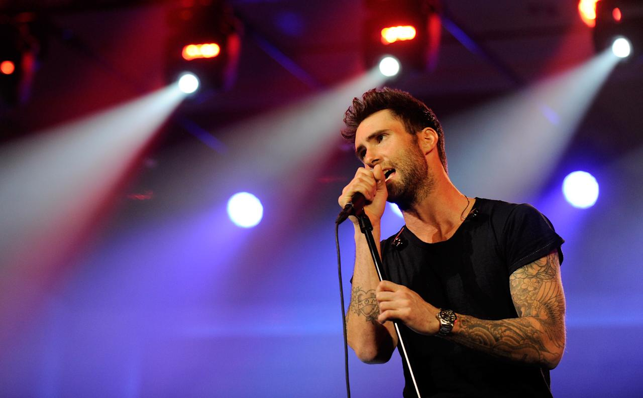 LAS VEGAS, NV - JANUARY 07:  Singer Adam Levine of Maroon 5 performs during a keynote address at the 2013 International CES at The Venetian on January 7, 2013 in Las Vegas, Nevada. CES, the world's largest annual consumer technology trade show, runs from January 8-11 and is expected to feature 3,100 exhibitors showing off their latest products and services to about 150,000 attendees.  (Photo by David Becker/Getty Images)