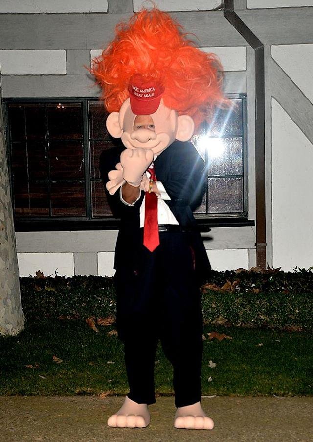 <p>Perry's boyfriend at the time went as now-President Donald Trump. (Photo: Splash News) </p>