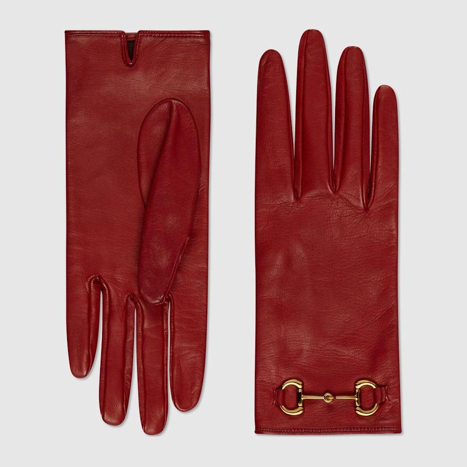 """<p><strong>Gucci</strong></p><p>gucci.com</p><p><strong>$590.00</strong></p><p><a href=""""https://go.redirectingat.com?id=74968X1596630&url=https%3A%2F%2Fwww.gucci.com%2Fus%2Fen%2Fpr%2Fwomen%2Faccessories-for-women%2Fhats-gloves-for-women%2Fgloves-for-women%2Fleather-gloves-with-horsebit-p-603635BAP006600&sref=https%3A%2F%2Fwww.townandcountrymag.com%2Fstyle%2Ffashion-trends%2Fg35537938%2Fbest-leather-gloves-women%2F"""" rel=""""nofollow noopener"""" target=""""_blank"""" data-ylk=""""slk:Shop Now"""" class=""""link rapid-noclick-resp"""">Shop Now</a></p>"""