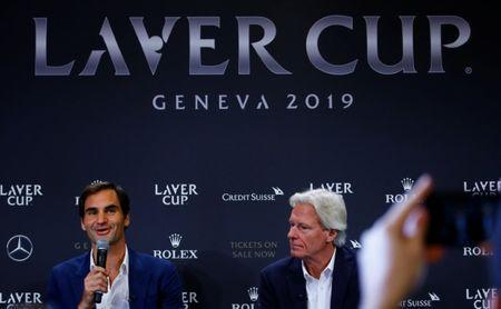 Bjorn Borg of Sweden (R) sits beside as Switzerland's Roger Federer addresses a news conference to promote the Laver Cup tennis tournament in Geneva, Switzerland February 8, 2019. REUTERS/Arnd Wiegmann