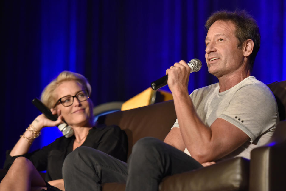 Gillian Anderson and David Duchovny seen on Day 2 at Wizard World Comic-Con at the Donald E Stephens Convention Center on Saturday, Aug. 25, 2018, in Rosemont, Ill. (Photo by Rob Grabowski/Invision/AP)