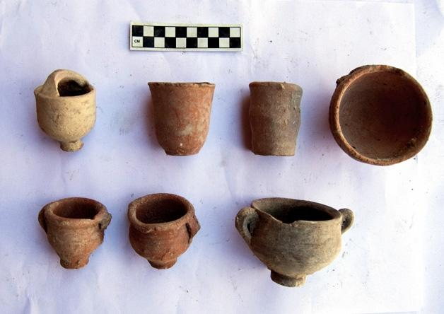 A handout picture released by Egypt's antiquities ministry on July 4, 2018 shows collected pottery fragments dating from Greek, Roman, Coptic, and Islamic eras discovered hidden in a museum in Alexandria