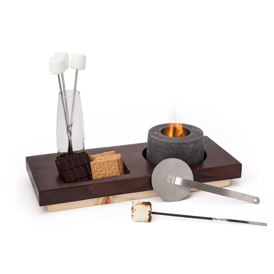 <p>This <span>Indoor S'mores Fire Pit</span> ($175) makes for the ultimate winter gift.</p>