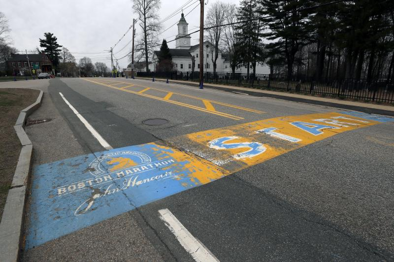 FILE - In this Monday April 20, 2020 file photo, the Boston Marathon start line in Hopkinton, Mass., is vacant on the scheduled day of the 124th race, due to the COVID-19 virus outbreak. The 2020 Boston Marathon, which was rescheduled to run on Sept. 14th, was canceled Thursday May 28, 2020, for the first time in its 124-year history. (AP Photo/Charles Krupa)