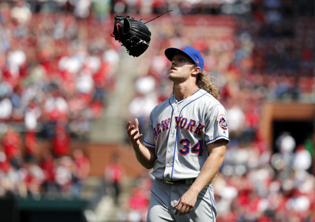 New York Mets starting pitcher Noah Syndergaard flips his glove as he walks off the field after being removed during the eighth inning of a baseball game against the St. Louis Cardinals, Thursday, April 26, 2018, in St. Louis. (AP Photo/Jeff Roberson)