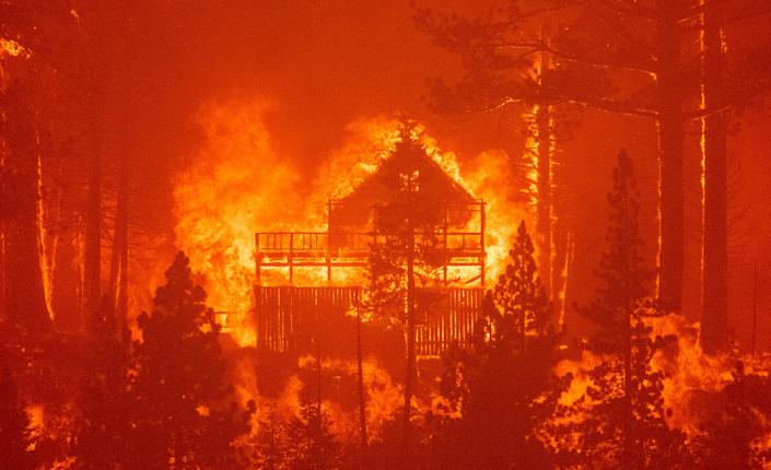 Flames consume multiple homes as the Caldor Fire pushes into South Lake Tahoe, Calif., on Aug. 30.