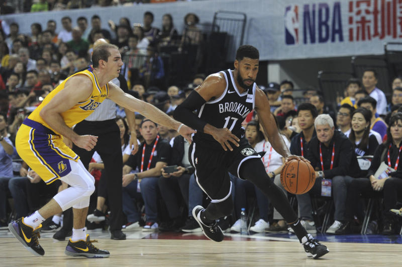 Brooklyn Nets' Garrett Temple, right, in action against Los Angeles Lakers during a match at the NBA China Games 2019 in Shenzhen in south China's Guangdong province on Saturday, Oct. 12, 2019 (Color China Photo via AP)