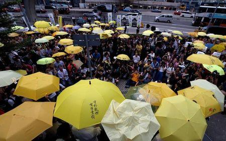 FILE PHOTO: Pro-democracy protesters carrying yellow umbrellas, symbol of the Occupy Central civil disobedience movement, stage a three-minute silence outside government headquarters in Hong Kong to mark the second anniversary of the movement, China September 28, 2016. REUTERS/Bobby Yip