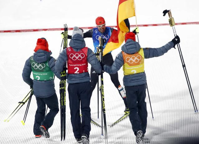 Nordic Combined Events - Pyeongchang 2018 Winter Olympics - Men's Team 4 x 5 km Final - Alpensia Cross-Country Skiing Centre - Pyeongchang, South Korea - February 22, 2018 - Johannes Rydzek of Germany celebrates with his teammates Fabian Riessle, Vinzenz Geiger and Eric Frenzel of Germany. REUTERS/Dominic Ebenbichler