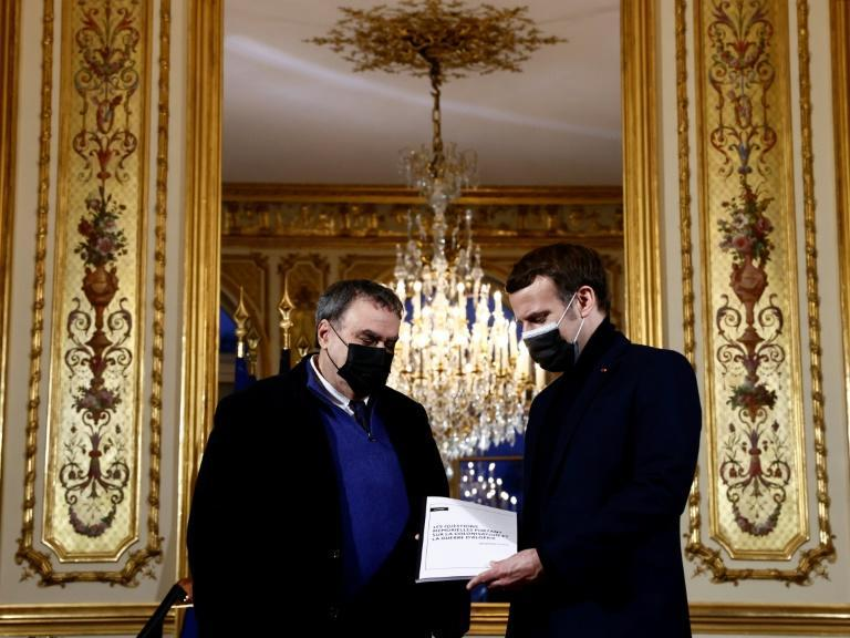 French President Emmanuel Macron (R) meets in January at the Elysee Palace with historian Benjamin Stora for a report on France's colonisation of Algeria and the Algerian War for independence.