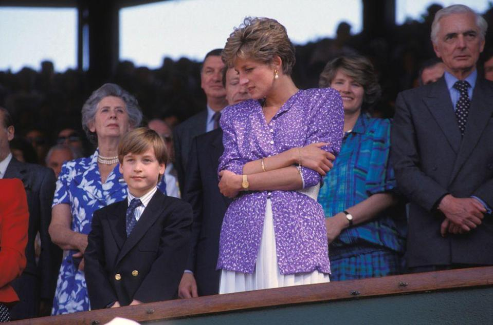 <p>Princess Diana wore a purple, ditsy-print blouse over a white pleated skirt to watch Wimbledon with her eldest son, Prince William. </p>