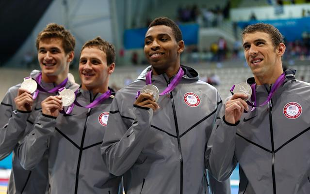 LONDON, ENGLAND - JULY 29: (L-R) Adrian Nathan, Ryan Lochte, Cullen Jones and Michael Phelps of the United States pose with the silver medals won during the Men's 4 x 100m Freestyle Relay final on Day 2 of the London 2012 Olympic Games at the Aquatics Centre on July 29, 2012 in London, England. (Photo by Jamie Squire/Getty Images)