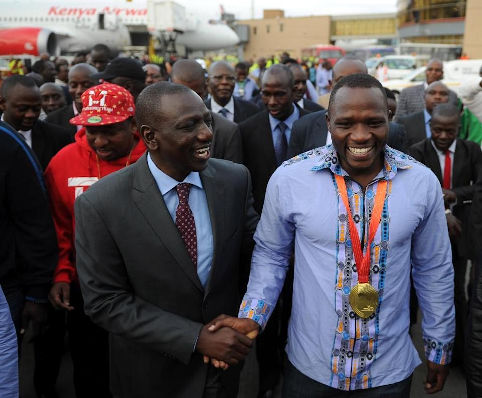 Javelin gold medalist at the 2015 IAAF World Championships, Julius Yego (right), is received by Kenya's Deputy President William Ruto at Jomo Kenyatta airport in Nairobi on September 1, 2015 (AFP Photo/Tony Karumba)