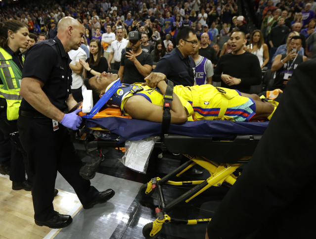 Warriors guard Patrick McCaw is taken off the court on a stretcher after falling hard to the floor late in the third quarter following a Flagrant 1 foul by the Kings' Vince Carter on Saturday. (AP)
