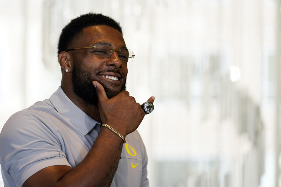 FILE - Oregon defensive end Kayvon Thibodeaux poses for photos during the Pac-12 Conference NCAA college football Media Day in Los Angeles, in this Tuesday, July 27, 2021, file photo. Thibodeaux was selected to The Associated Press Preseason All-America first team defense, Monday Aug. 23, 2021. (AP Photo/Marcio Jose Sanchez)