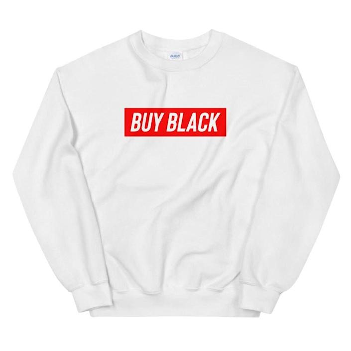 "Get the <a href=""https://shop.obws.com/collections/buy-black/products/buy-black-sweatshirt"" rel=""nofollow noopener"" target=""_blank"" data-ylk=""slk:&quot;Buy Black&quot; sweatshirt from Official Black Wall Street for $40"" class=""link rapid-noclick-resp"">""Buy Black"" sweatshirt from Official Black Wall Street for $40</a>"