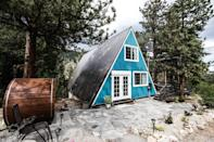 "<p>Ok, so the blue exterior and graffiti'd mural on the bottom side of the deck don't <em>scream</em> Scandinavia—but the Finnish steam sauna (left) and cozy grey interiors do. Located about an hour's drive into the Rockies from Denver, this A-frame has two bedrooms (one in the loft) and plenty of outdoor living space, including two decks and a porch area. There's also a large kitchen stocked with all of the basics. A stay here will definitely be of the digital detox variety, since the Wi-Fi isn't super strong and the home does not have a TV (there is an iPad for streaming that can serve as a hotspot).</p> <p><strong>Book now:</strong> <a href=""https://airbnb.pvxt.net/N3BaK"" rel=""nofollow noopener"" target=""_blank"" data-ylk=""slk:From $150 per night, airbnb.com"" class=""link rapid-noclick-resp"">From $150 per night, airbnb.com</a></p>"