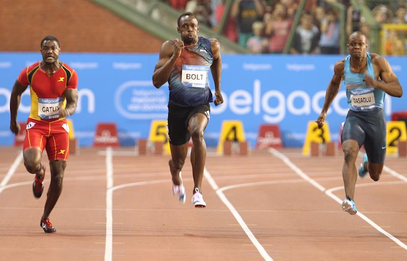 Usain Bolt from Jamaica, center, runs to win the men's 100 meters at the Diamond League Memorial Van Damme athletics event, at Brussels' King Baudouin stadium, on Friday, Sept. 6, 2013. At left is Justin Gatlin from the U.S., at right is James Dasaolu from Great Britain. (AP Photo/Yves Logghe)