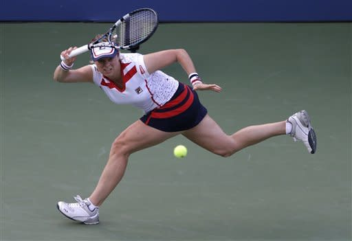 Kim Clijsters of Belgium returns a shot to Laura Robson of Great Britain in the second round of play at the 2012 US Open tennis tournament, Wednesday, Aug. 29, 2012, in New York. (AP Photo/Darron Cummings)