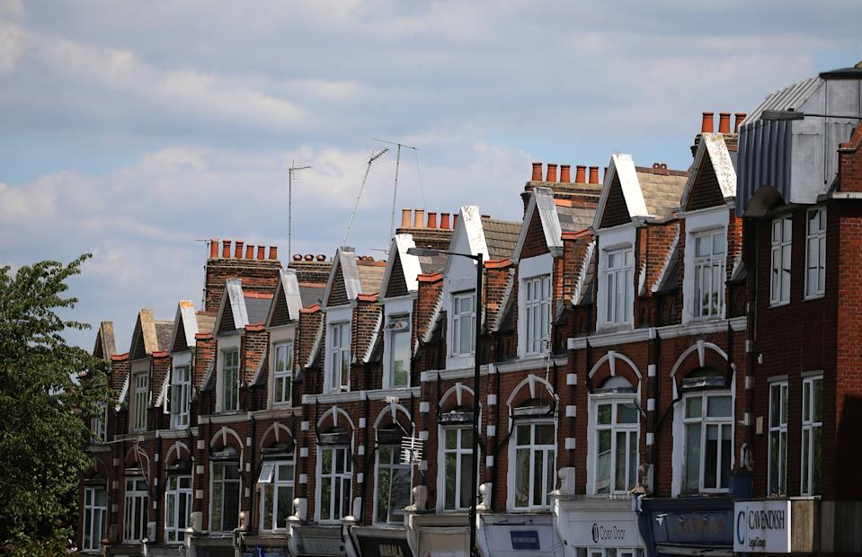 A row of terraced residential houses in north London. Chancellor Rishi Sunak has confirmed temporary plans to abolish stamp duty on properties up to 500,000 GBP in England and Northern Ireland as part of a package to dull the economic impact of the coronavirus. Picture date: Sunday July 12, 2020.