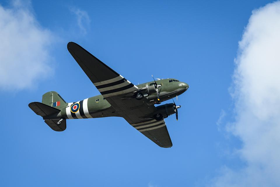 BEDFORD, ENGLAND - FEBRUARY 27: A vintage C-47 Dakota performs a flypast over Bedford crematorium as a funeral service for Sir Tom Moore takes place on February 27, 2021 in Bedford, England. WWII veteran, Sir Tom raised nearly £33 million for NHS charities ahead of his 100th birthday last year by walking laps of his garden in Marston Moretaine, Bedfordshire. He died on the 2nd of February after testing positive for COVID-19. (Photo by Leon Neal/Getty Images)