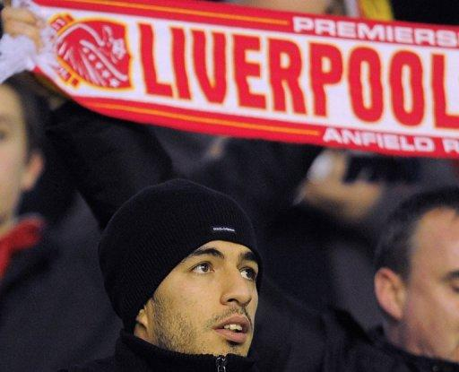 Liverpool's Uruguayan forward Luis Suarez looks on from the terraces during the FA Cup football match between Liverpool and Oldham Athletic at Anfield in Liverpool, on January 6. Liverpool will face bitter rivals Manchester United in a home FA Cup fourth round tie that will be played against the backdrop of Suarez's ban for racially abusing United's Patrice Evra