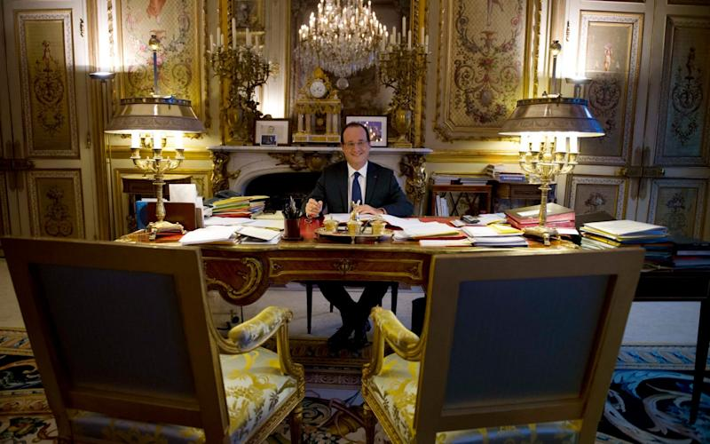President Hollande in his office during a photo session at the Elysee Palace in 2012. - Reuters