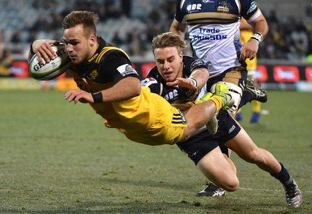 Rugby Union - Super Rugby - Wellington Hurricanes vs ACT Brumbies - Canberra, Australia - July 21, 2017 - Wes Goosen of the Wellington Hurricanes dives to score a try during the quarterfinal Super Rugby match.   AAP/Mick Tsikas/via REUTERS