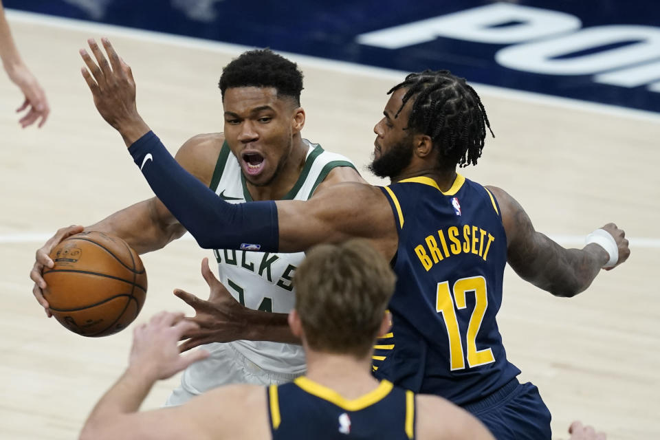 Milwaukee Bucks' Giannis Antetokounmpo (34) goes to the basket against Indiana Pacers' Oshae Brissett (12) during the second half of an NBA basketball game Thursday, May 13, 2021, in Indianapolis. (AP Photo/Darron Cummings)
