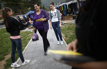 Volunteers hand leaflets with information about new Bosnia's census in Jablanica, 60 kilometres (37 miles) south of Sarajevo, September 27, 2013. REUTERS/Dado Ruvic