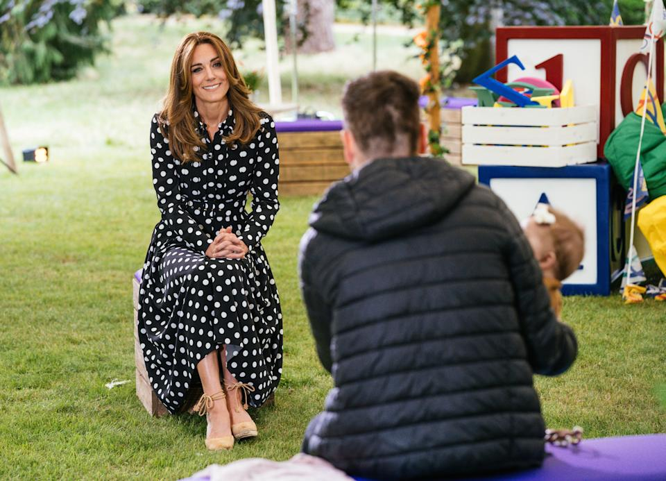 EMBARGOED TO 2230 MONDAY JULY 13 Undated handout photo issued by Kensington Palace of the Duchess of Cambridge with Ryan and his eight-month-old daughter, to mark the launch of a new BBC education resource called Tiny Happy People.