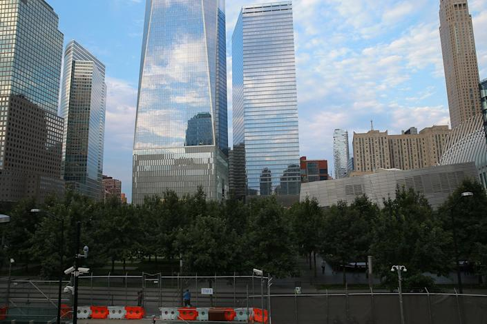 <p>A view of the National September 11 Memorial & Museum grounds, with One World Trade Center looming in the background, Aug. 31, 2016. (Gordon Donovan/Yahoo News) </p>