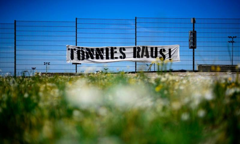 A banner reading 'Tönnies Out' at the FC Schalke ground.