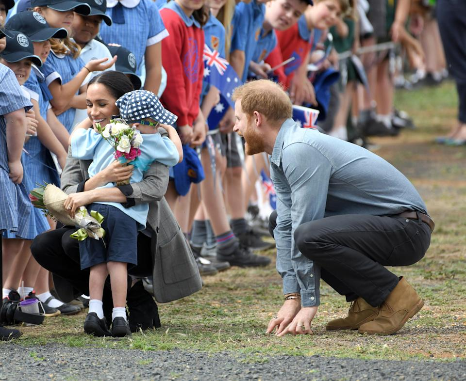 The five-year-old Dubbo schoolboy gave Meghan a bunch of flowers and a huge hug. Source: Getty