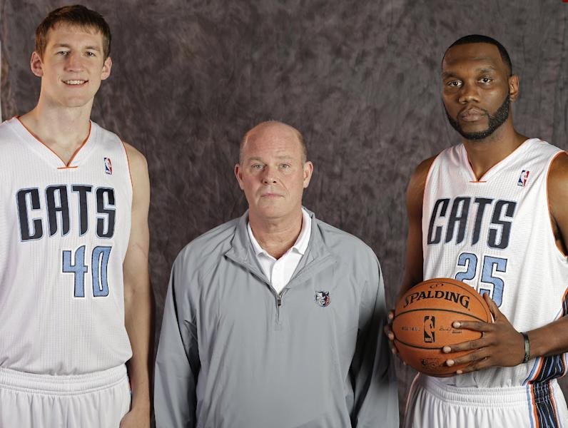 Charlotte Bobcats head coach Steve Clifford, center, poses with Cody Zeller, left, and Al Jefferson, right, for a photo during the NBA basketball team's media day in Charlotte, N.C., Monday, Sept. 30, 2013. (AP Photo/Chuck Burton)