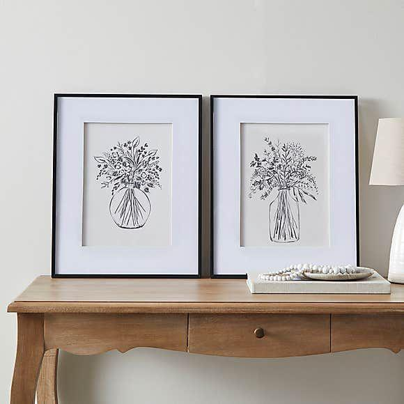 """<p>Dunelm, £30</p><p><a class=""""link rapid-noclick-resp"""" href=""""https://go.redirectingat.com?id=127X1599956&url=https%3A%2F%2Fwww.dunelm.com%2Fproduct%2Fchurchgate-linen-floral-prints-1000188383&sref=https%3A%2F%2Fwww.countryliving.com%2Fuk%2Fhomes-interiors%2Finteriors%2Fg37349094%2Fcountry-wall-art%2F"""" rel=""""nofollow noopener"""" target=""""_blank"""" data-ylk=""""slk:Shop now"""">Shop now</a></p><p>A charming pair of floral illustrations in scratchy, inky strokes on textured watercolour paper - perfect for the minimal country home. Pre-framed with mount, this pair will make a happy centrepiece to a gallery wall. <br></p>"""