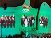 "FILE PHOTO: ""Family Photo"" for annual G20 Summit World Leaders is projected onto Salwa Palace in At-Turaif, one of Saudi Arabia's UNESCO World Heritage sites, in Diriyah"
