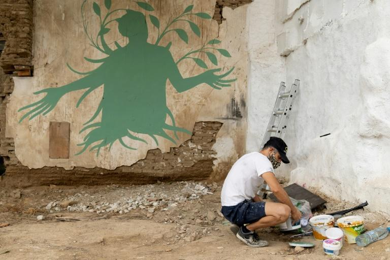 Fikos is a student of Byzantine iconography who dabbled in graffiti and street art before coming up with his unique style. He has been commissioned to paint murals in many countries, including France, Mexico, Serbia and Ukraine