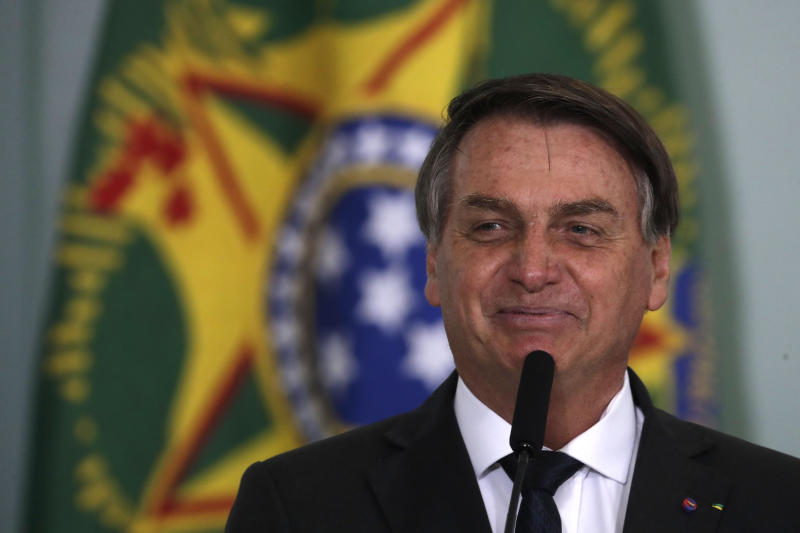 "Brazil's President Jair Bolsonaro, smiles while speaking at a ceremony launching the housing program ""Green and Yellow House,"" at the Planalto presidential palace in Brasilia, Brazil, Tuesday, Aug. 25, 2020, amid the new coronavirus pandemic. (AP Photo/Eraldo Peres)"