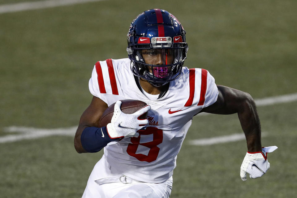 Mississippi wide receiver Elijah Moore (8) runs for yardage during an NCAA college football game against Vanderbilt, Saturday, Oct. 31, 2020, in Nashville, Tenn. Moore was selected to The Associated Press All-America first-team offense, Monday, Dec. 28, 2020. (AP Photo/Wade Payne)