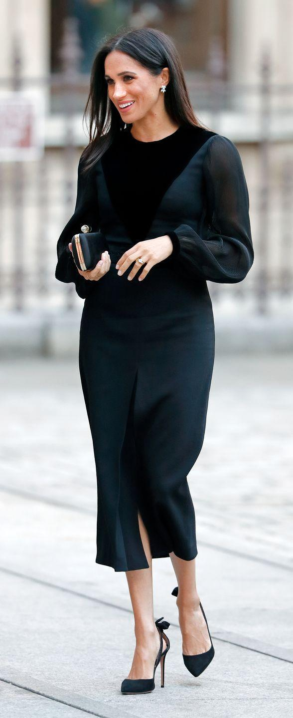 """<p>For her first solo engagement as a royal, the duchess wore a black long-sleeved Givenchy dress - which featured sheer panels, a calf-length skirt, billowy sleeves and a darker panel on the torso. She accessorised the demure look with <a href=""""https://www.farfetch.com/uk/shopping/women/aquazzura-deneuve-105-pumps-item-13085027.aspx?storeid=9774&size=18&pid=googleadwords_int&af_channel=Search&c=629762120&af_c_id=629762120&af_keywords=aud-296930551369%3Apla-383089413039&af_adset_id=52804059504&af_ad_id=218064673083&is_retargeting=true&shopping=yes&gclid=EAIaIQobChMIwoqstJXY3QIV1kwNCh21yAPgEAQYASABEgISCPD_BwE"""" rel=""""nofollow noopener"""" target=""""_blank"""" data-ylk=""""slk:slingback Aquazzura pumps"""" class=""""link rapid-noclick-resp"""">slingback Aquazzura pumps</a>, a Givenchy satin clutch with jewellery clasp (you can buy similar <a href=""""https://www.net-a-porter.com/gb/en/product/1071894?cm_mmc=Google-ProductSearch-UK--c-_-NAP_EN_UK_PLA-_-NAP%C2%A0-%C2%A0UK%C2%A0-%C2%A0GS%C2%A0-+Designer+-+Class_Bags+-+Type_Clutch+Bags%C2%A0-%C2%A0High%C2%A0-%C2%A0BT--Clutch+Bags+-+Box_INTL&gclid=EAIaIQobChMInaPug5bY3QIVSODICh0I4QJDEAQYBiABEgIOg_D_BwE&gclsrc=aw.ds"""" rel=""""nofollow noopener"""" target=""""_blank"""" data-ylk=""""slk:here"""" class=""""link rapid-noclick-resp"""">here</a>), and <a href=""""https://www.maisonbirks.com/en/birks-snowflake-snowstorm-diamond-earrings-in-white-gold"""" rel=""""nofollow noopener"""" target=""""_blank"""" data-ylk=""""slk:Birks Snowflake snowstorm diamond earrings"""" class=""""link rapid-noclick-resp"""">Birks Snowflake snowstorm diamond earrings</a> in white gold.</p>"""