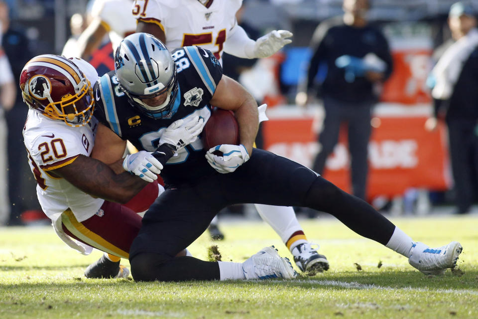 Washington Redskins strong safety Landon Collins (20) tackles Carolina Panthers tight end Greg Olsen (88) during the first half of an NFL football game in Charlotte, N.C., Sunday, Dec. 1, 2019. (AP Photo/Brian Blanco)
