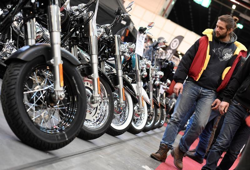 Harley-Davidson bikes are lined up at a bike fair in Hamburg