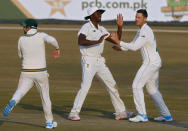 South Africa's George Linde, right, celebrates with teammates after taking the wicket of Pakistan's Fawad Alam during the third day of the second cricket test match between Pakistan and South Africa at the Pindi Stadium in Rawalpindi, Pakistan, Saturday, Feb. 6, 2021. (AP Photo/Anjum Naveed)