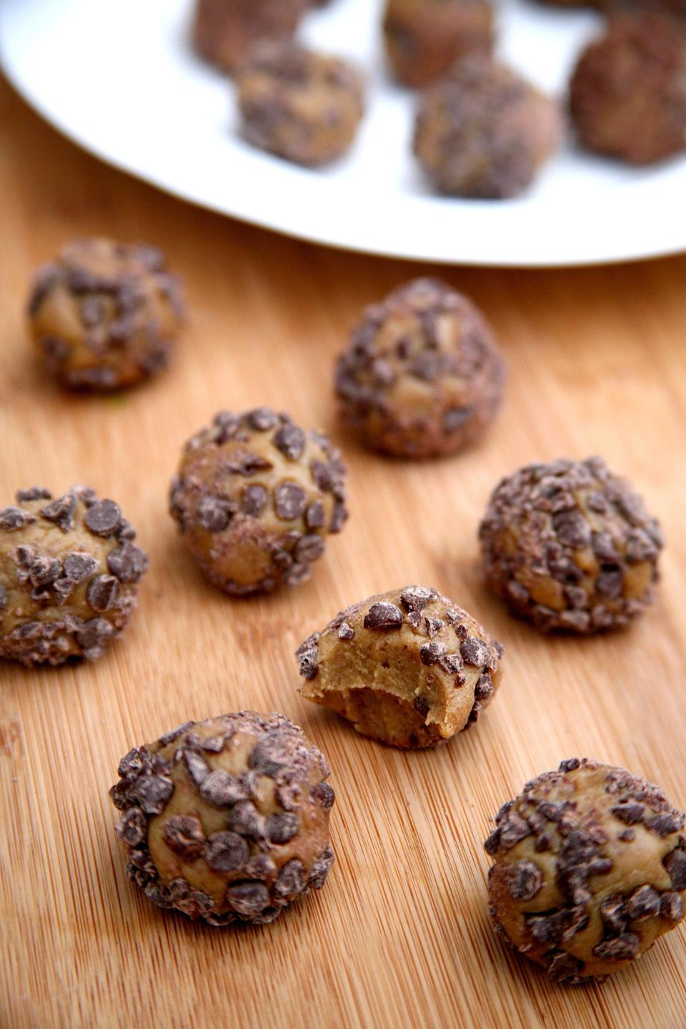 """<p>All you need is a food processor or high-speed blender, and you'll be biting into these soft, cookie-dough-like protein balls in a matter of minutes.</p> <p><strong>Get the recipe:</strong> <a href=""""https://www.popsugar.com/fitness/Chocolate-Peanut-Butter-Protein-Balls-40039099"""" class=""""link rapid-noclick-resp"""" rel=""""nofollow noopener"""" target=""""_blank"""" data-ylk=""""slk:chocolate chip peanut butter protein balls"""">chocolate chip peanut butter protein balls</a></p>"""